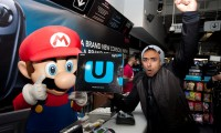 Izzy Rahman 25 from London is the first to buy the Nintendo Wii U from the HMV store on LondonÕs Oxford Street, after queuing for 6 days for the launch.   PRESS ASSOCIATION Photo. Picture date: Friday November 30, 2012. Photo credit should read: David Parry/PA